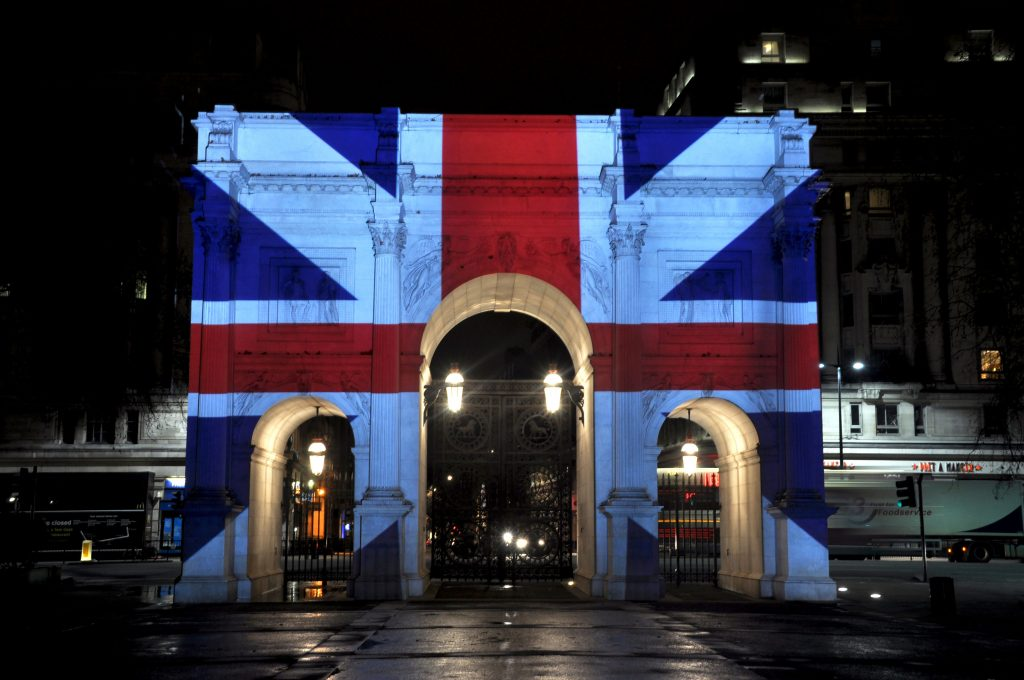 Very bright and sharp guerilla artwork projection onto building, Marble Arch, in London