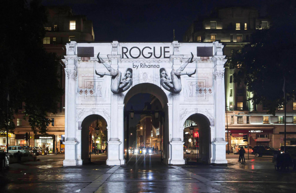 Guerrilla building projection on Marble Arch in London for launch of Rogue by Rihanna